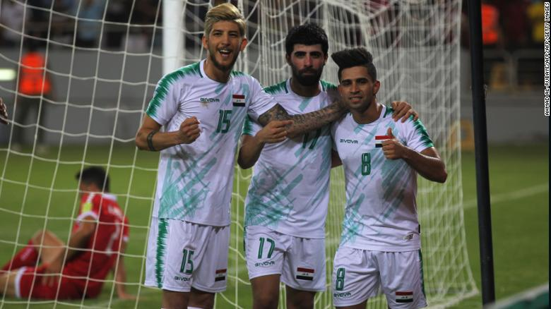 Iraq midfielder Ali Hussein (R) celebrates his goal during the the 2019 WAFF Championship match between Iraq and Lebanon in Karbala on July 30, 2019
