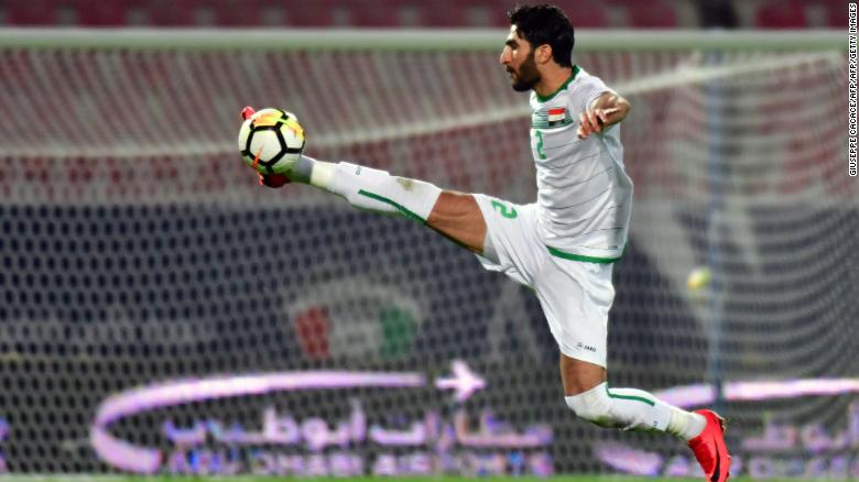 Ahmad Ibrahim stops the ball in mid-air during his 2017 Gulf Cup of Nations football match between Iraq and Bahrain in Kuwait City on December 23, 2017.