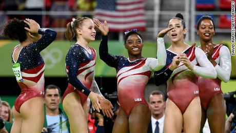 Laurie Hernandez, Madison Kocian, Simone Biles, Aly Raisman and Gabby Douglas of the United States celebrate winning the team gold medal at the Rio 2016 Olympic Games in 2016.