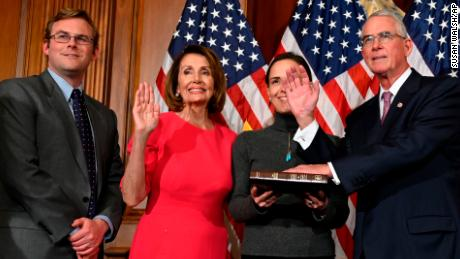 Speaker of the House Nancy Pelosi poses during a ceremonial ceremony with Rooney, right, on Capitol Hill in Washington in January.