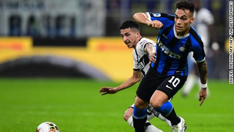 Parma's Italian midfielder Matteo Scozzarella (L) and Inter Milan's Argentinian forward Lautaro Martinez go for the ball.