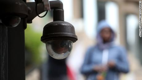 A video surveillance camera hangs from the side of a building on May 14, 2019 in San Francisco, California.