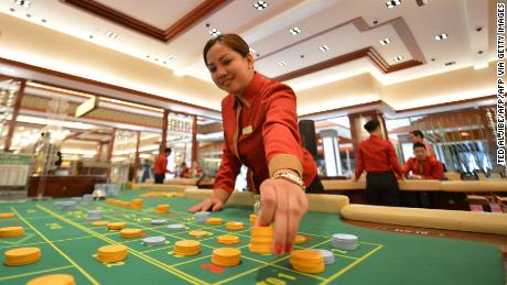 An employee of Solaire Manila Resorts and casino checks chips. In their free time, POGO employees often gamble and end up in debt, falling prey to loan sharks.