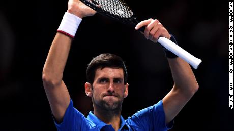 Novak Djokovic of Serbia celebrates is straight sets victory over Italian Matteo Berrettini in their opening match of the ATP Finals in London.