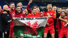 "Wales celebrate with the infamous ""Wales. Golf. Madrid flag."""