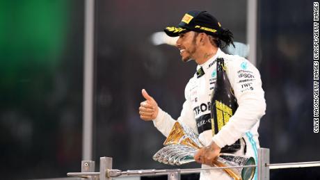 Hamilton celebrates on the podium after the Abu Dhabi Grand Prix.