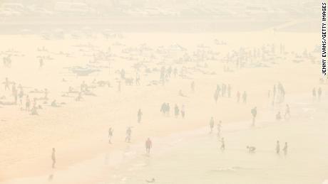 The mist of forest fires is seen on Bondi Beach in Sydney on December 10, 2019.