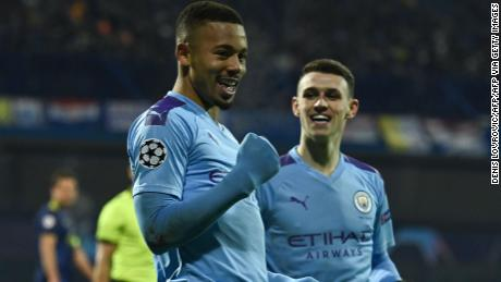 Manchester City's Brazilian striker Gabriel Jesus (L) celebrates after scoring against Dinamo Zagreb.