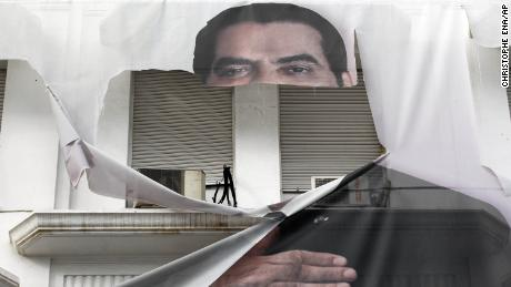 A torn banner of former Tunisian President Zine El Abidine Ben Ali in the center of Tunis in January 2011.