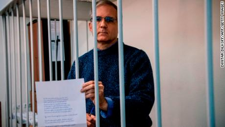 Paul Whelan, a former US maritime detective accused and arrested in Russia in December 2018, carries a message as he stands inside the defendant;  Cage before the hearing in October 2019.