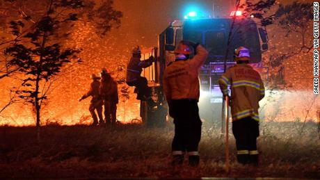 Firefighters battle bushfires around the town of Nowra, New South Wales, on December 31, 2019.