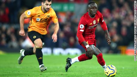 Mane (right) controls the ball against Wolves last month.