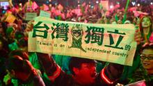 A supporter of Taiwan President Tsai Ing-wen displays a banner outside the campaign headquarters in Taipei on January 11, 2020.