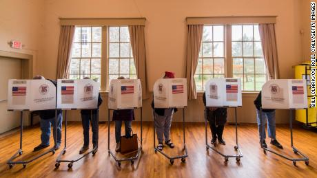 Voters fill out their ballots at a polling station in Virginia in 2018.