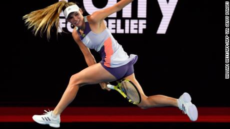 """Caroline Wozniacki attempts a """"tweener"""" (between the legs shot) during the Rally for Relief charity match in Melbourne"""