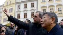 The mayors of Prague and Taipei walk through the Old Town Square in Prague on January 13, 2020.