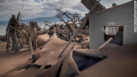 Houses near the crater of the Taal volcano are seen buried in the volcanic ash on the volcanic island of Taal.