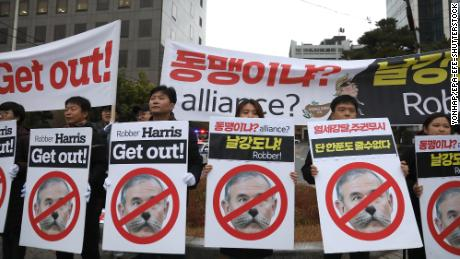 Members of Seoul Jinbo, a civic group of progressive activists, hold a rally near the residence of US Ambassador to South Korea Harry Harris in Seoul on November 11, 2019. His face is superimposed with a cat because he joked on Twitter that his cats were OK after a group of students broke into his house.