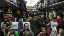 This photo taken on February 10, 2018 shows passengers travelling on a crowded train during the 26-hour journey from Beijing to Chengdu, as they head home ahead of the Lunar New Year.