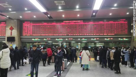 Commuters wait in line at Wuchang railway station in Wuhan on Wednesday.