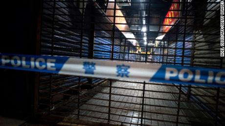 Members of staff of the Wuhan Hygiene Emergency Response Team conduct searches of the closed Huanan Seafood Wholesale Market in the city of Wuhan, in the Hubei Province, on January 11.