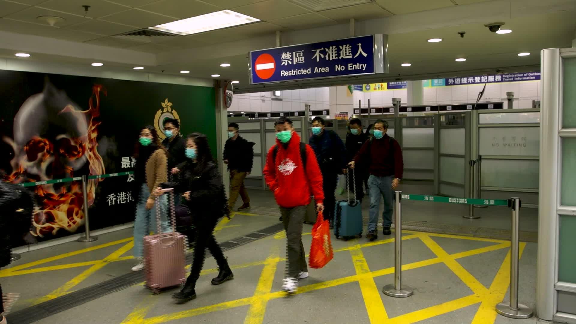 Hong Kong restricts border crossings with mainland China to ...