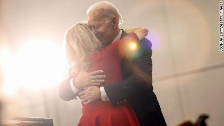 Jill Biden hugs her husband, Democratic presidential candidate and former Vice President Joe Biden, on February 2, 2020.
