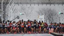 Runners start the Tokyo Marathon 2019.