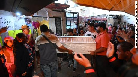 People carry the coffin during the seven-year-old Fátima funeral, whose body was found on the weekend.