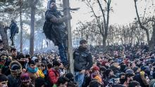 Migrants gather at the Turkey-Greece border on February 29, 2020, where clashes took place with Greek police.