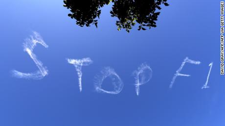 """The words """"Stop F1"""" are seen over the Sydney sky."""