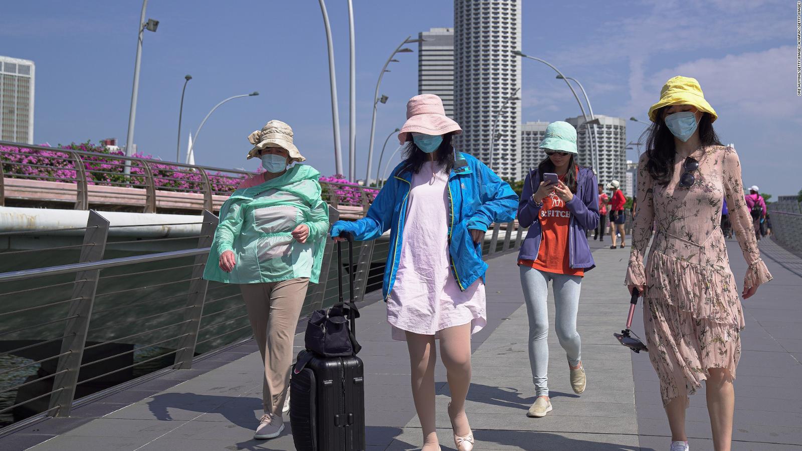 Will warmer weather help fight the coronavirus? Singapore and ...