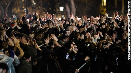 Supporters celebrate PSG's second goal against Dortmund after the match was played behind closed doors.