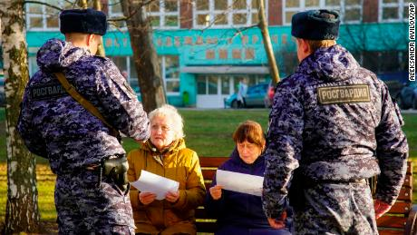 Russian Rosguardia (National Guard) soldiers speak to pensioners in Moscow, as the city ordered residents over 65 and those suffering from chronic conditions to stay home for 19 days.