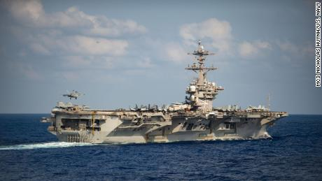 Navy launches broader investigation into aircraft carrier infected with virus
