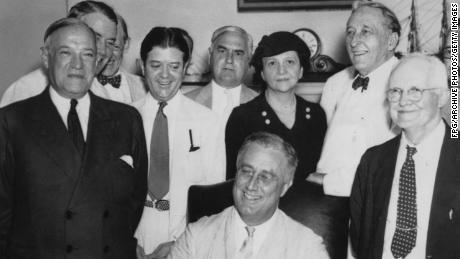 President Franklin D. Roosevelt (seated) signs the Social Security Act on August 14, 1935.