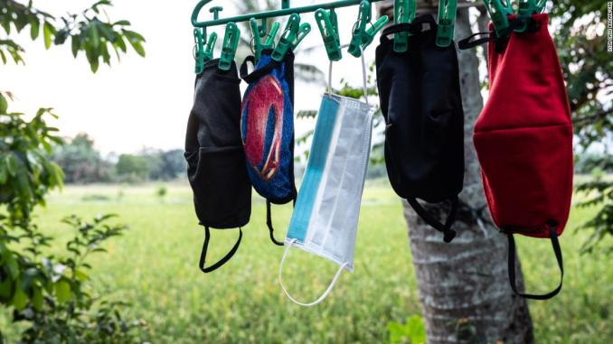 April Abrias' facemasks are hung out to dry after being washed so they can be reused.