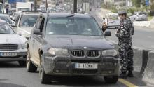 Lebanese security forces stop cars at a highway checkpoint north of Beirut on April 6, as authorities implemented further measures restricting the movement of vehicles.