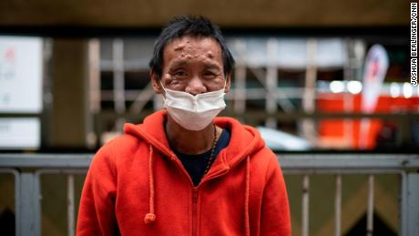 Lum Chai, 45, is seen during the meal service of the Impact HK on Tuesday, April 7.