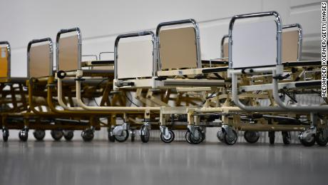 Newly installed hospital beds for coronavirus patients at the Hanover exhibition center in Germany on April 4. The facility has 500 beds for patients who do not require intensive care.