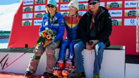 Shiffrin (C) poses with her parents Eileen and Jeff after winning the women's slalom race at the 2017 FIS Alpine World Ski Championships in St Moritz on February 18, 2017.