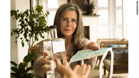 Inverroche founder Lorna Scott brandishes a bottle of her company's gin.