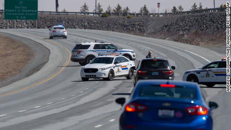 Police block highway in Enfield, Nova Scotia on Sunday, April 19, 2020. Canadian police arrested a suspect on Sunday in an investigation into an active shooter after declaring earlier that he may have driven a vehicle resembling a police car and wearing a police uniform.
