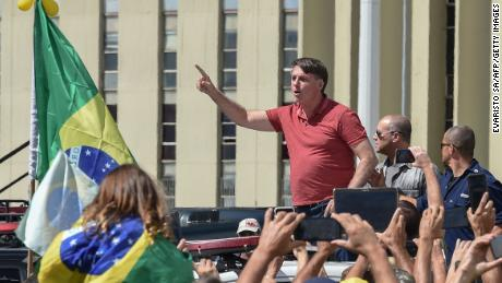 Brazilian President Jair Bolsonaro speaks after joining his supporters to protest the quarantine and social distancing measures on April 19, 2020.