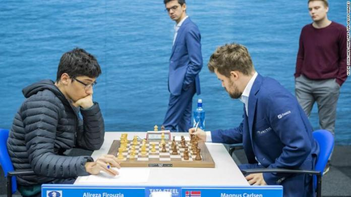 Firouzja (L) against Carlsen during the ninth round of the Tata Steel Chess Tournament in Wijk aan Zee, the Netherlands.