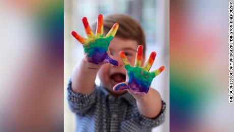 Prince Louis painted a rainbow over the published photos to mark his second birthday.