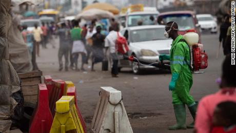 A city worker disinfects a market in Accra, Ghana in March, as the virus begins to spread around the world.