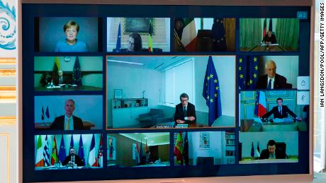 A picture shows a screen of a video conference call between members of the European Council, seen at the Elysee Palace in Paris, on March 26, 2020, to discuss coordination of EU efforts to tackle the outbreak of covid-19.