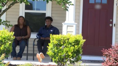 Monica and Dameon Shepard sit on their porch, where they faced questions from the group.