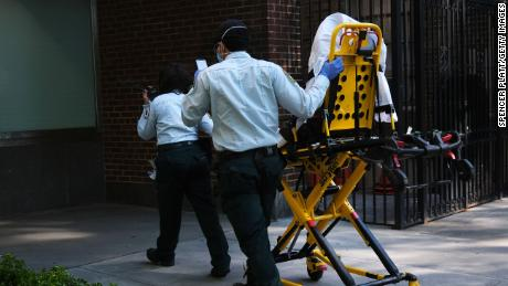 Medics take a stretcher into a Manhattan hospital that has been at the forefront of the coronavirus outbreak on May 12, 2020 in New York City. Across America, people are reeling from the loss of jobs and incomes as unemployment soars to historical levels following the COVID-19 outbreak. While some states are beginning to re-open slowly, many business are struggling to find a profit with the new restrictions and a population that is fearful of the contagious virus.